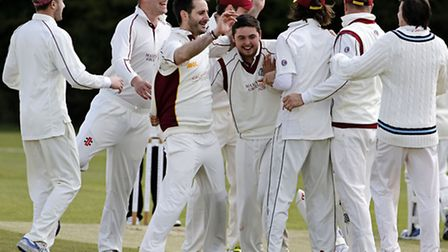 March Town celebrate taking a wicket against Huntingdon. Photo: Pat Ringham