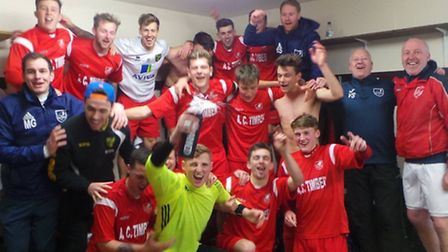 Ely City celebrate their promotion to the Thurlow Nunn Premier Division after their 2-1 win over Lei