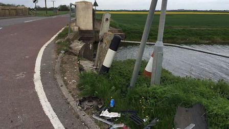 Cambridgeshire County Council putting temporary traffic lights at B1093/ B1098 junction after damag