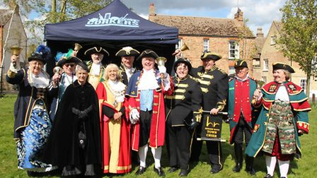 The participants in the Ely Town Crier competition with Ely town crier, Avril Hayer-Smith (far left)