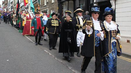 The participants in the Ely Town Crier competition march down Fore Hill.