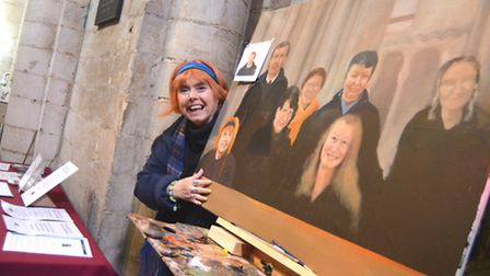 Admissions Assistant Vicky Cole, with the painting of some of the staff at the Secret Life of Ely Ca
