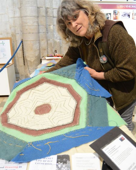 Artist Jane Frost, with some quilts on show at the Secret Life of Ely Cathedral exhibition.