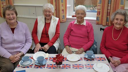 Celebrating HM The Queen's 90th Birthday with tea and cakes at St Peter's Church March. Left: Janet
