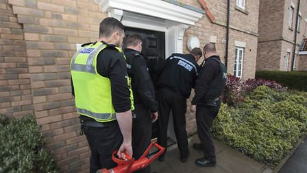 Police enter the property. Operation Edison, Cambridgeshire Police conduct drug warrants at various