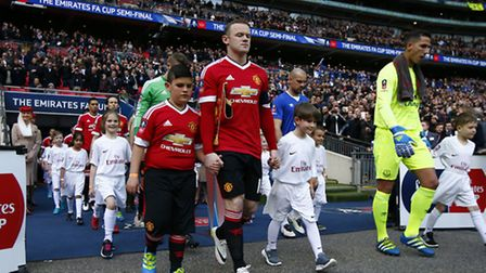 11-year-old Harvey Hopkin leads Manchester United captain out on the pitch before Manchester United'