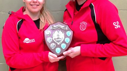 Ely Netball Club players Sharon Coxall and Jo Hayward with the trophy for finishing second in Divisi