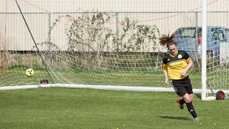 March Town Ladies' Shannon Kelly wheels away after netting her hat-trick against Bourne Ladies. Phot