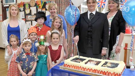 Burrowmoor Nursey wishes the Queen a Happy 90th Birthday. Left: Staff members Rebecca Stimson and He