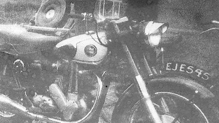 Man is looking for motor cycle.
