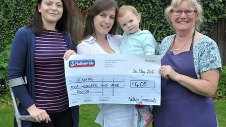 Scamps reps Marie Cass and Amy Kent with Isabelle and founder member of Nellie's Community Cafe, Joy