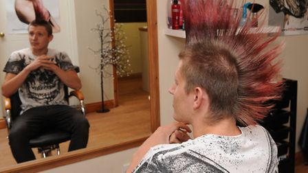 Luke Green having his mohican shaved off for cancer research by Bethan Lenton. Picture: Rob Morris.