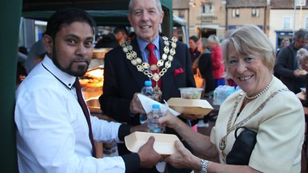 The Mayor and Mayoress, Ian and Suzanne Lindsay receive their food at the Ramadan Feast