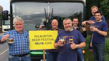 Cllr Bill Hunt joins beer festival organisers at Wilburton to promote the Zipper bus
