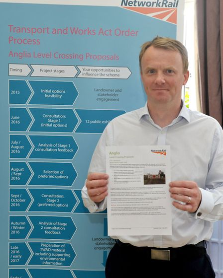 Level crossings closure exhibition at March community centre. Dan from Network Rail project team wit