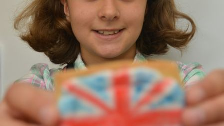 Ely Museum Crafts Day, Charlotte, from Ely, with her Union Jack biscuit