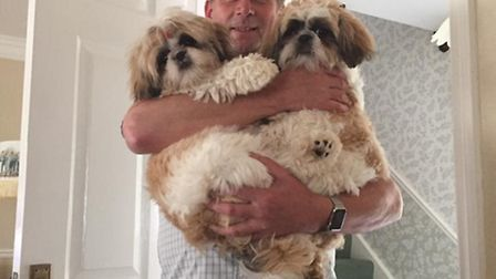 Peter Grice and family celebrating return of pups