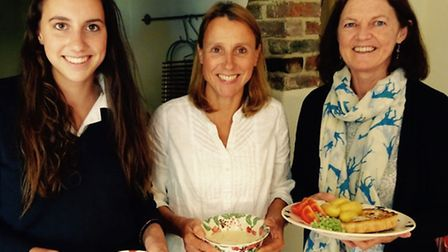 The supper servers: Caroline Scott-Bowden (centre), with daughter Isabel (left) and Jacquie Evans