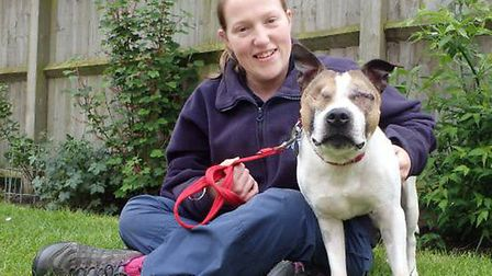 The RSPCA is searching for a home for Pooch, pictured here with RSPCA animal care assistant, Vicky C