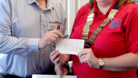 March Lions have recently presented a cheque to Positive People Care, a group that caters to people