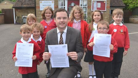 Little Thetford Head Teacher Johnny Wallace, with some of his pupils, celebrating a good Ofsted repo