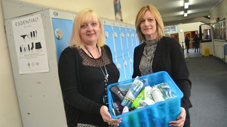 Student services manager at Witchford College, Alison Douglas, receives a box of toiletries from Eas