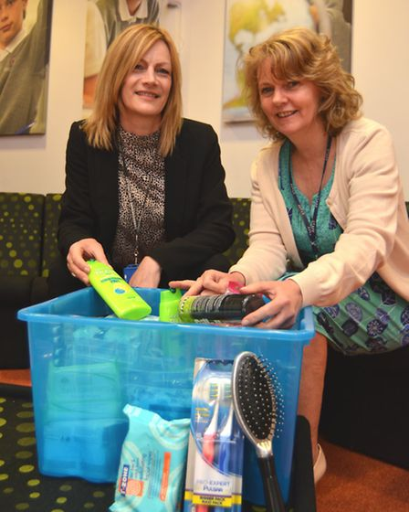 Lynn Richies, Safeguarding Officer at Ely College, with the college's donate box of toiletries.