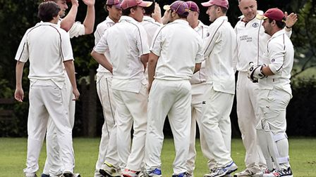 March celebrate taking a wicket in their five wicket success over Granta 2nds. Photos: Pat Ringham
