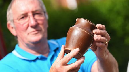 Lew Gray with the pot which will now be examined by experts. Picture: Ian Burt
