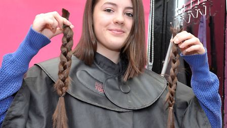 13 year old Keira Evans having Hair cut for Little Princess charity by Claire Baker. Picture: Steve