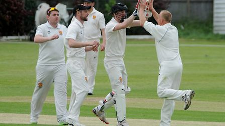 Dunmow celebrate a wicket. Picture by Jamie Pluck