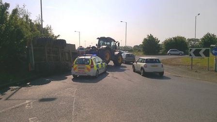 Overturned water butt on A10 near Ely