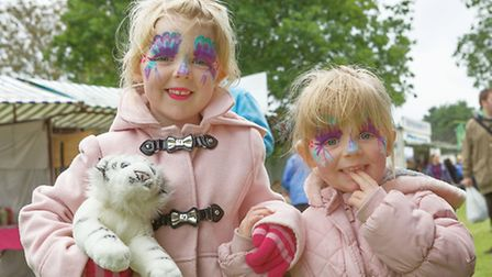 Soham Carnival. Poppy aged 6 and Holly aged 3 having had their faces painted. Picture: Barry Gidding