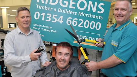 Guy Tyers having his head shaved at Ridgeons March. Left: Operations manager Dave Dring Guy Tyers a