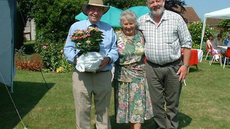 Ely Rotary: Our photo shows the bouquet presented to Enid Bedford, with John Bedford holding it, and