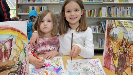Lauren and Maisie Martinali with Maggie Jeffrey's latest book, The Colour Fairies. Picture: Steve Wi