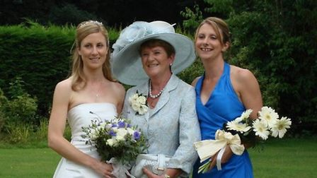 Sally Talbot (right) with her mum Rosemary (centre) who died of cancer last year and her sister Kati