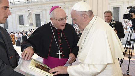 Bishop Alan Hopes presenting the letters, artwork and book to Pope Francis