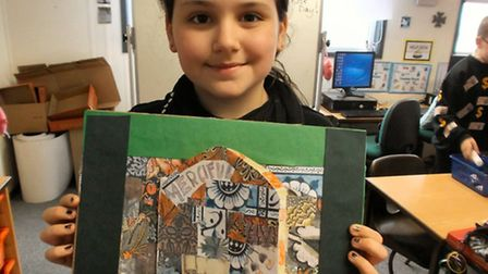 All Saints pupil Dolly with her Door of Mercy which was taken to Rome.