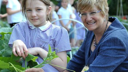 Allotment opening.Weatheralls School, Soham. Weatheralls pupil with Head teacher Chrissy Barclay. Pi