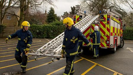 Passerby helps save dog from from kitchen blaze in Kent Close, Ely
