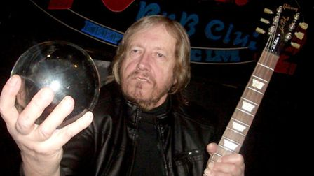 Philip Solomon and guitar and crystal ball.