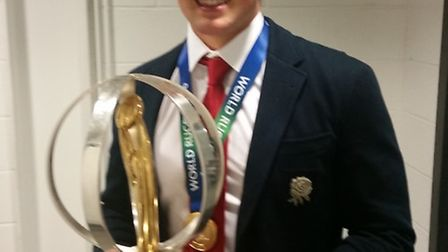 Max Malins holds the U20 World Rugby Championship Trophy