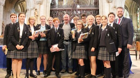 King's Ely Junior pupils with British ski jumping legend, Eddie the Eagle, at their prizegiving at E