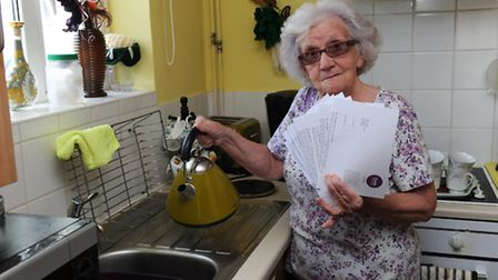 Caroline Toth at home in Lyons Court with letters from Circle Housing Roddons