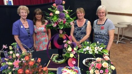 President of the City of Ely Flower Club, Joyce Svensson, with annual show winners Margaret Dooling,