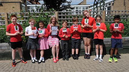 Benita Sherrington, head of Year 3 and 4 at Rackham School with pupils from yr 3,4,5, and 6.