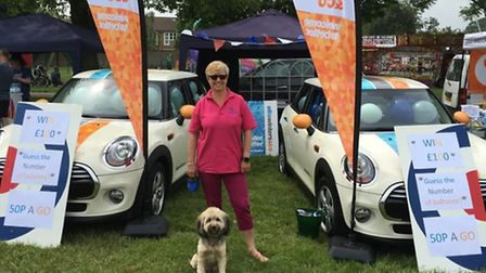 Linda Ellis with Lotttie the dog at the Ellis Winters & Co stand