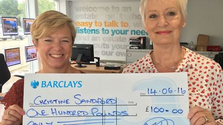 Christine Sandford, right, collects her £100 prize cheque from Linda Ellis at Ellis Winters & Co off