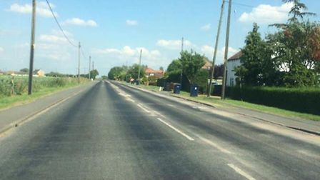 Wimblington Road, Doddington where the tarmac has melted in patches